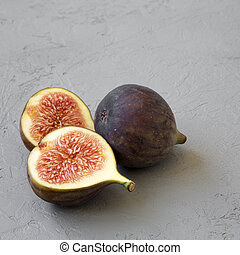 Fresh figs on grey background, side view. Closeup.