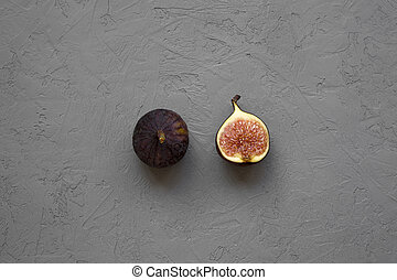 Fresh figs on grey background, top view. Overhead, from above.