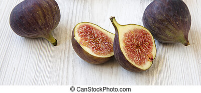 Fresh figs on white wooden background, side view. Close-up.