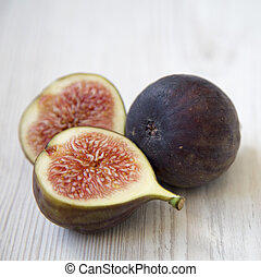 Fresh figs on white wooden table, side view. Close-up.