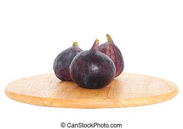 Fresh figs on wooden board