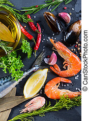 Fresh fish and seafood with herbs background