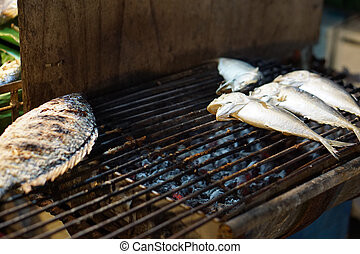 fresh fish on a grill over fire