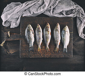 fresh fish perch and carp cleaned from scales
