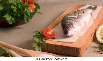 Fresh fish sea bass on wooden table.