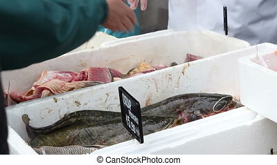 Fresh Fish Selling - Customers buying fresh fish from a...