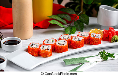 fresh fish sushi with red caviar on the table 1