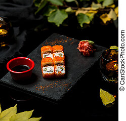 fresh fish sushi with red caviar
