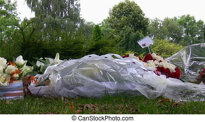 Fresh flower bouquets on grass - Fresh flower bouquets with...