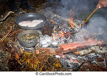 Fresh food preparation at camp fire - Fresh fish fillets...