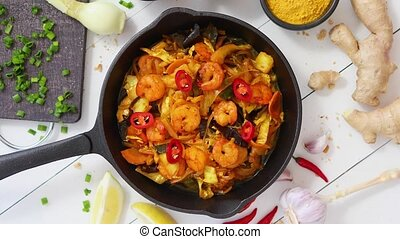 Fresh fried noodles with vegetables with shrimps served in ...