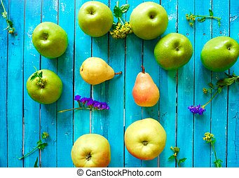 Fresh fruit apples and pears on a blue background