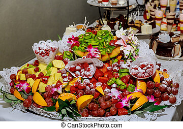 Fresh fruit assorted on table in restaurant.