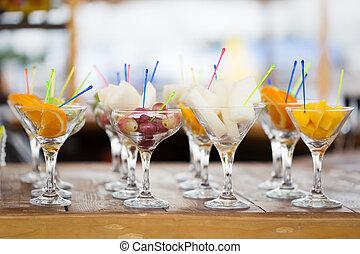 Fresh fruit cuts in champagne glasses