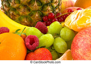Fresh fruit diversity with pineapple, bananas strawberries and raspberries