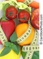 Fresh fruit for diet - Fruits and vegetables with measuring...