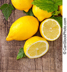 Fresh fruit - Fresh lemons on wooden table, top view