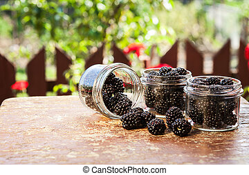 Fresh fruit in a jar on a wooden table