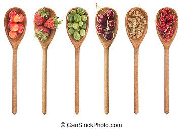 Fresh fruit in a wooden spoon