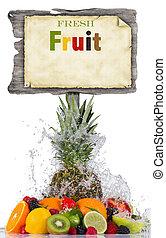 Fresh fruit in water splash and wooden board
