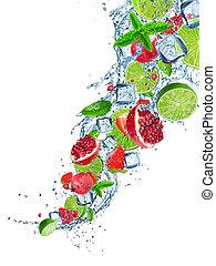 Fresh fruit in water splash over white