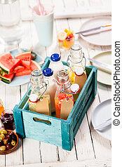Fresh fruit juice and milk in glass bottles
