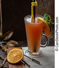 fresh fruit juice with piece of lemon in the glass