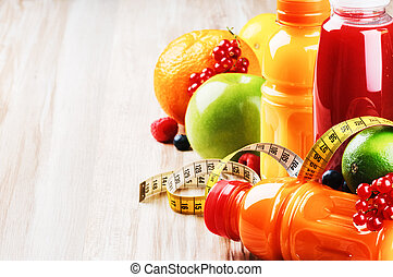 Fresh fruit juices in healthy nutrition setting with copyspace