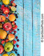 Fresh fruit mix placed on old wooden planks - Close-up of ...