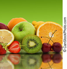 Fresh fruit on a green background