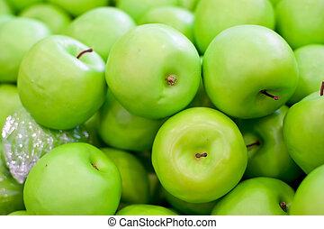Fresh fruit on the shelves, green apple
