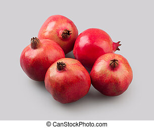 fresh fruit pomegranate on a gray background