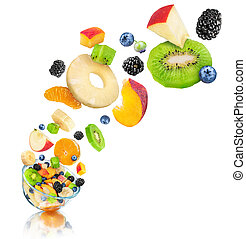 fresh fruit salad in a glass bowl with reflection on an isolated white background