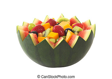 Fresh fruit salad of mango, strawberry, kiwi and grapes in a bowl from watermelon isolated on white (Selective Focus, Focus in the middle of the fruit salad)