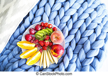 Fresh fruit salad on a blue plaid with place for text