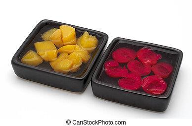 Fresh fruit salad on the two black bowls