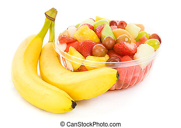 Bowl of fruit salad and two ripe, delicious bananas isolated on white.