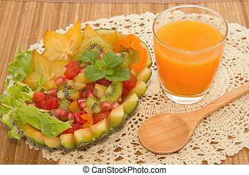Fresh fruit salad with orange juice, fusion food for diet