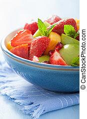 fresh fruit salad with strawberry, apple, nectarine, pomegranate