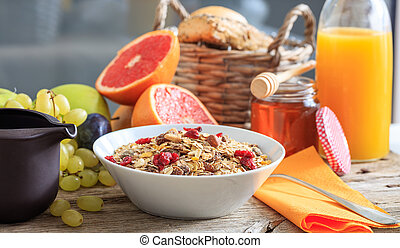 Fresh fruits and cereal bowl on a wooden table