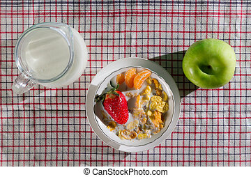 Fresh fruits and corn flakes with milk