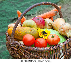 Fresh fruits and vegetables in a wicker basket