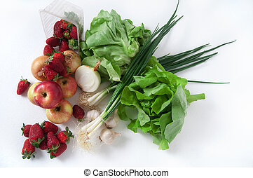 Fresh fruits and vegetables on desk
