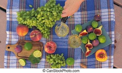 Fresh fruits and white wine