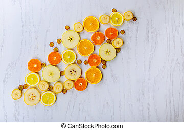 Fresh fruits background. Slices of fresh fruits top view
