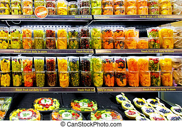 Fresh fruits - Big shelf in supermarket with fresh fruits