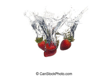 Fresh fruits dropped into water with splash on white background