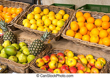Fresh fruits in baskets at a market