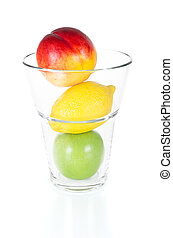 Fresh fruits in glass isolated on white