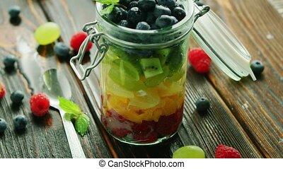 Fresh fruits in glass jar - Closeup fresh ripe fruits...
